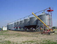 Fast in fast out auger system with a grain pump