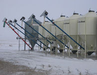 Cow/Calf and feedlot operation mixes feed using the greain pump.